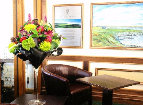 RC 06-300,00 Ron-Aranjament floral cu anthurium, crizanteme si crini
